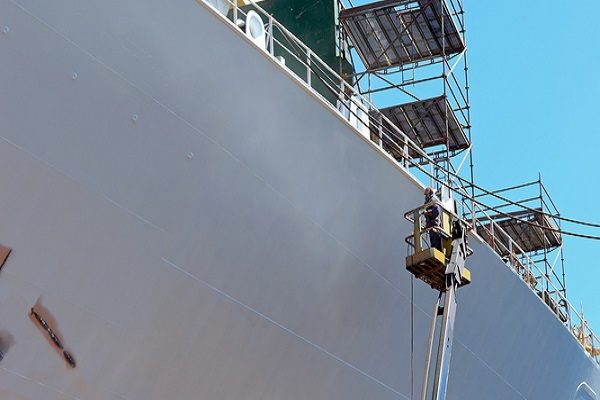 painter painting ship safely