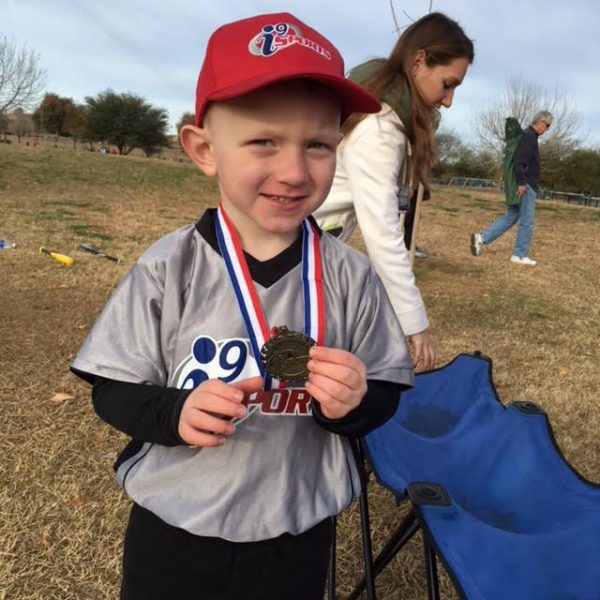 ron's grandson with medal