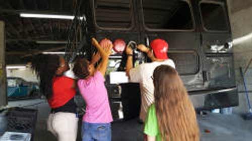 DHS Students painting school bus